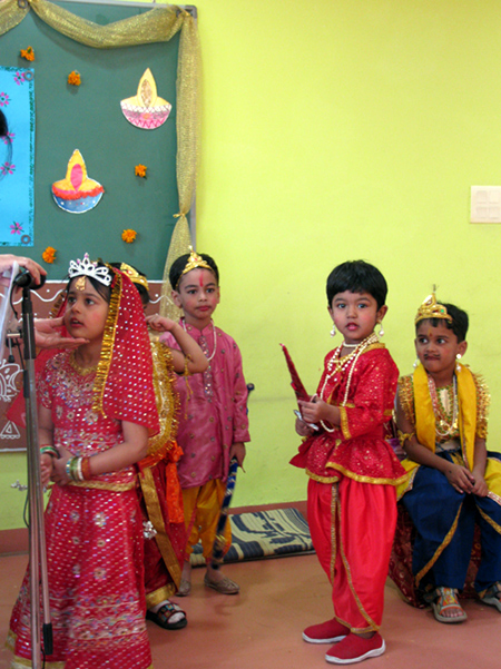 Rhea as Mantri looks on as Sita delivers